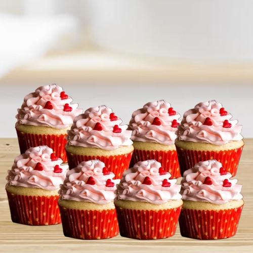 Lavish Gift of Vanilla Cup Cakes with Strawberry Topping