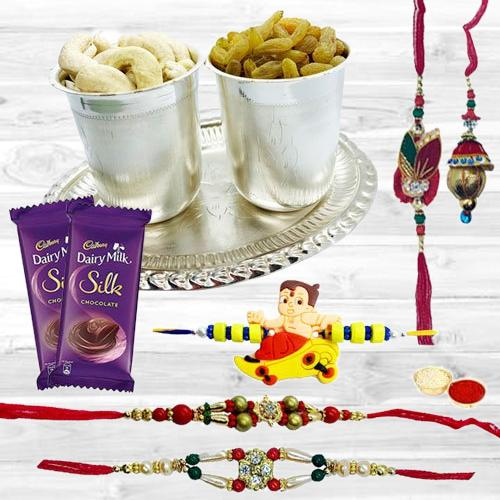Delicious Dry Fruits Hamper in Silver Plated Glasses and Tray with Cadbury Dairy Milk Silk n Family Set Rakhi