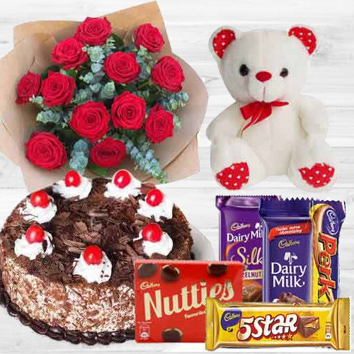 Breathtaking Bouquet of 12 Dutch Red Roses with 1 Lb Cake, Mixed Cadburys Chocolates and a Teddy Bear