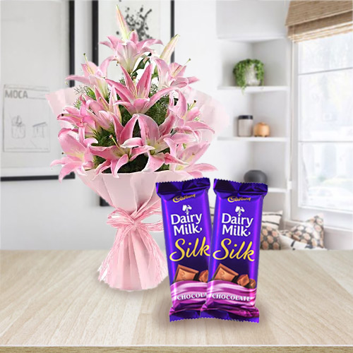 Wonderfully Arranged Oriental Pink Lilies with Dairy Milk Silk for Birth-Day
