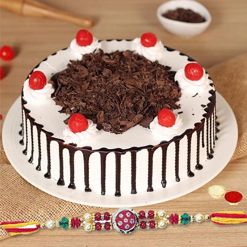 Mouth-Watering Black Forest Cake along with Rakhi and Free Roli Tika N Chawal for your Caring Brother