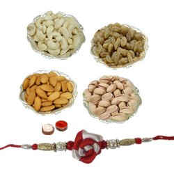 Breathtaking Display of Mixed Dry Fruits in Silver Plated Bowls with Free Rakhi, Roli Tilak and Chawal for your Precious Brother on the Occasion of Rakhi
