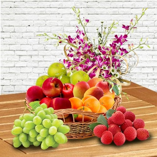 Basket of Fresh Fruits decorated with Orchids