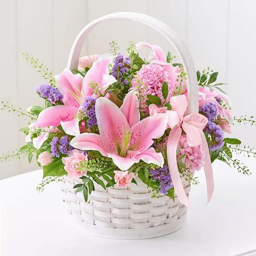 Basket Arrangement of Charming Lilies N Carnations
