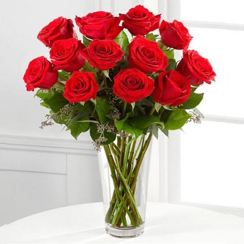 Mesmerizing Red Rose Arrangement in a Glass Vase