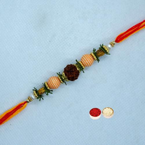 Enthralling Rudraksha Rakhi with free Roli Tilak and Chawal for your Precious Brother on the Occasion of Rakhi