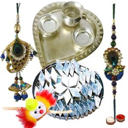 Spectacular Display of Silver Plated Paan Shaped Puja Aarti Thali, Delectable Kaju Katli, Bhaiya Bhabhi Rakhi Set and Kids Rakhi with Free Roli Tilak and Chawal for Rakhi Celebration