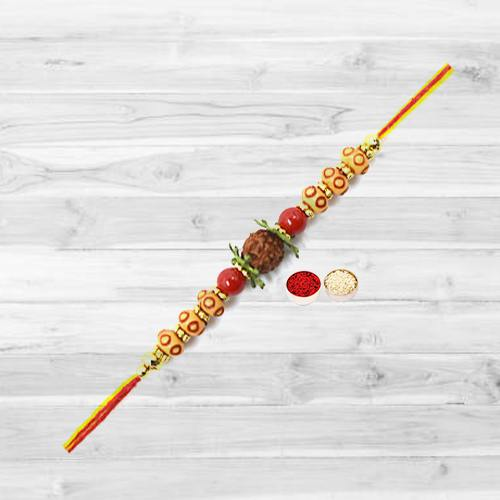 Wonderful Rudraksha Rakhi with Free Roli Tika and Chawal for your Dear Brother